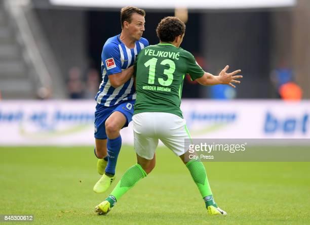 Vladimir Darida of Hertha BSC and Milos Veljkovic of Werder Bremen during the game between Hertha BSC and Werder Bremen on September 10 2017 in...