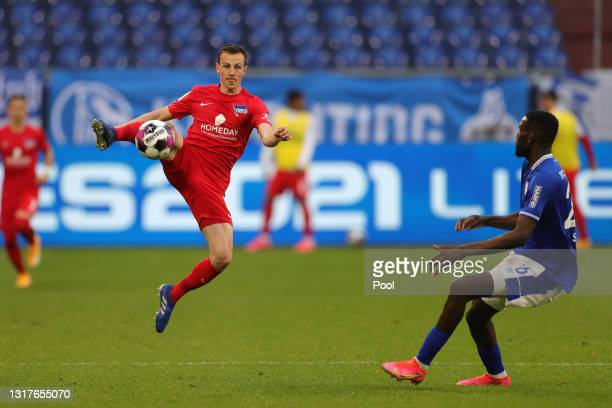 Vladimir Darida of Hertha BSC battles for possession with Salif Sane of FC Schalke 04 during the Bundesliga match between FC Schalke 04 and Hertha...