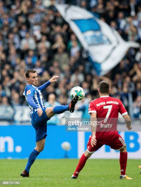 Vladimir Darida of Hertha BSC is challenged by Franck Ribery of FC Bayern Muenchen during the Bundesliga match between Hertha BSC and FC Bayern...