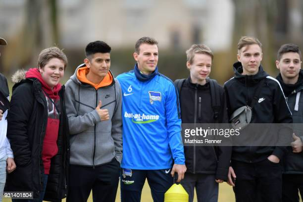 Vladimir Darida of Hertha BSC with fans before the training session at the Schenkendorfplatz on march 13 2018 in Berlin Germany