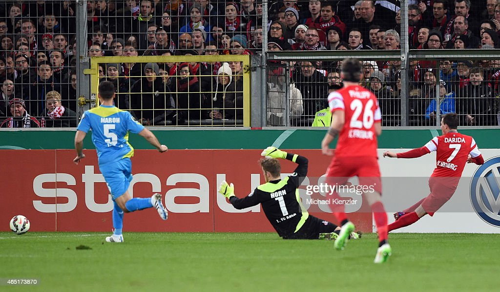 Vladimir Darida (R) of SC Freiburg shoots the second goal for Freiburg during the DFB Cup between SC Freiburg and 1. FC Koeln at Schwarzwald-Stadium on March 3, 2015 in Freiburg, Germany.