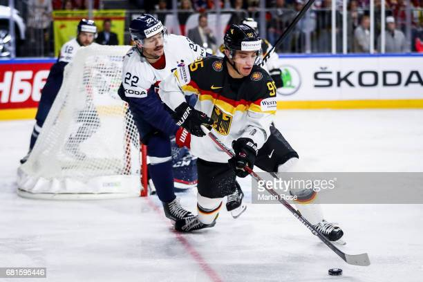 Vladimir Dravecky of Slovakia challenges Frederik Tiffels of Germany for the puck during the 2017 IIHF Ice Hockey World Championship game between...