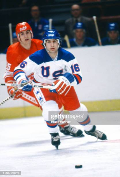 Vladimir Golikov of the USSR battles with Mark Pavelich of Team USA during the 1980 Olympic Games on February 22 1980 at the Olympic Center in Lake...