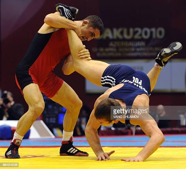Vladimir Gotsan of Moldavia competes with Adam Henryk Soberaj of Poland during a men's Free Style Wrestling 66kg semifinal match at the Senior...