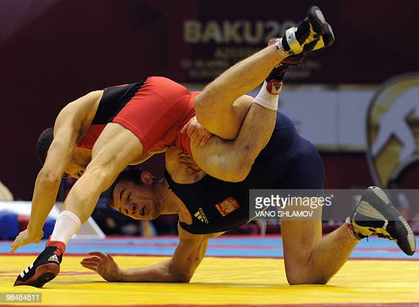 Vladimir Gotsan of Moldavia competes with Adam Henryk Soberaj of Poland during their men's Free Style Wrestling 66kg semifinal match at the Senior...