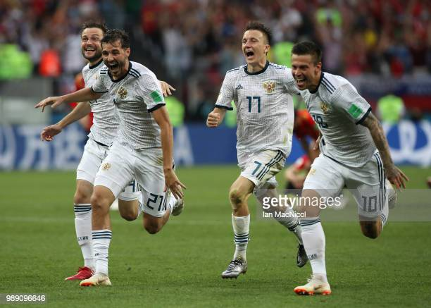 Vladimir Granat Aleksandr Erokhin Aleksandr Golovin and Fyodor Smolov of Russia celebrates when they win the penalty shoot out during the 2018 FIFA...
