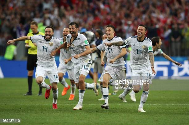 Vladimir Granat Aleksandr Erokhin Aleksandr Golovin and Fyodor Smolov of Russia celebrates when they win the penalty shoot out during the 2018 FIFA...