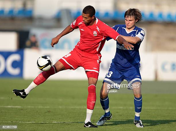 Vladimir Granat of FC Dinamo Moscow competes for the ball with Feliks of FC Spartak Nalchik during the Russian Football League Championship match...