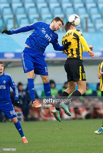 Vladimir Granat of FC Dynamo Moscow battles for the ball with Tamás Priskin of FC Alania Vladikavkaz during the Russian Premier League match between...