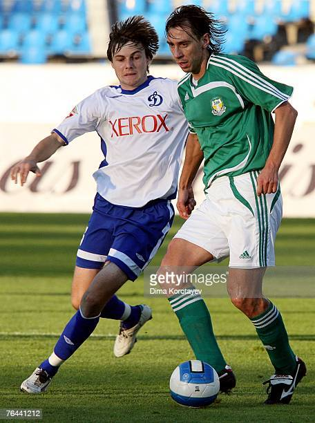 Vladimir Granat of FC Dynamo Moscow competes for the ball with Valeri Klimov of FC Tom Tomsk during the Russian Football League Championship match...