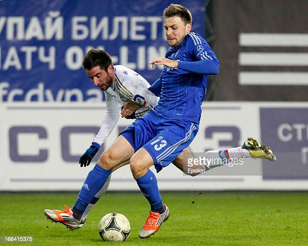 Vladimir Granat of FC Dynamo Moscow is challenged by Zoran Tosic of PFC CSKA Moscow during the Russian Premier League match between FC Dynamo Moscow...