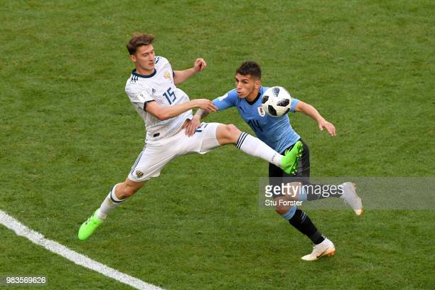 Vladimir Granat of Russia tackles Lucas Torreira of Uruguay during the 2018 FIFA World Cup Russia group A match between Uruguay and Russia at Samara...