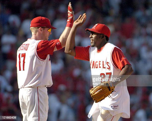 Vladimir Guerrero and Darin Erstad of the Anaheim Angels celebrate after 53 victory over the Oakland Athletics