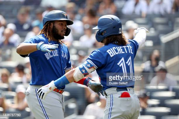 Vladimir Guerrero Jr. #27 celebrates his first inning home run with teammate Bo Bichette of the Toronto Blue Jays during a game aginst the New York...