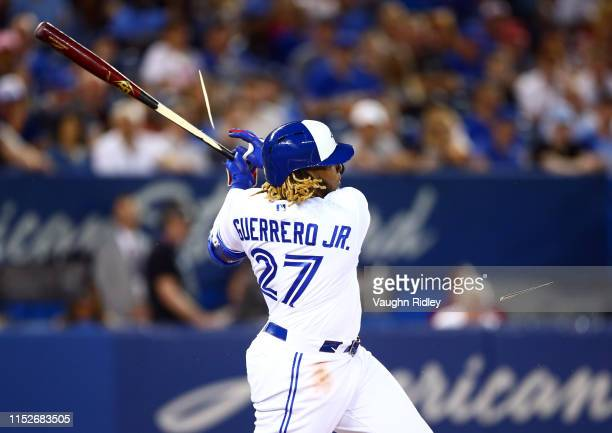 Vladimir Guerrero Jr #27 of the Toronto Blue Jays breaks his bat as he grounds out in the first inning during a MLB game against the Kansas City...