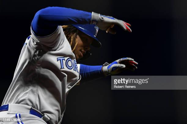 Vladimir Guerrero Jr. #27 of the Toronto Blue Jays celebrates after hitting a three-run home run in the sixth inning of their MLB game at Oracle Park...