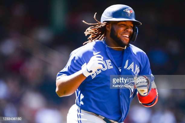 Vladimir Guerrero Jr. #27 of the Toronto Blue Jays celebrates after hitting a two-run home run in the seventh inning against the Boston Red Sox at...