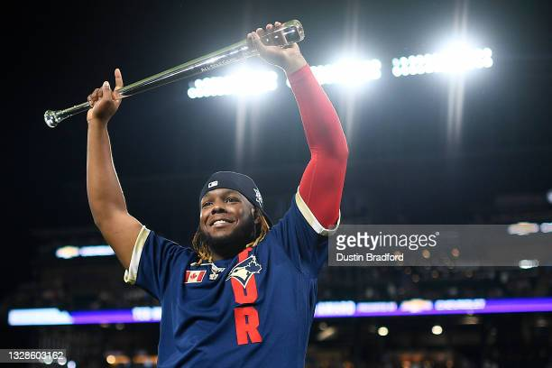 Vladimir Guerrero Jr. #27 of the Toronto Blue Jays celebrates after being awarded the MVP during the 91st MLB All-Star Game at Coors Field on July...