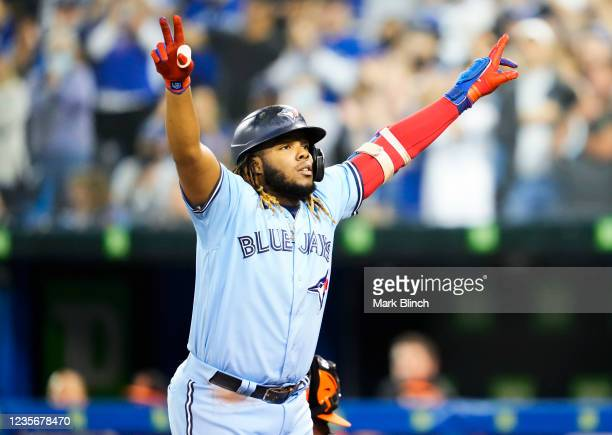 Vladimir Guerrero Jr. #27 of the Toronto Blue Jays celebrates his home run against the Baltimore Orioles in the second inning during their MLB game...