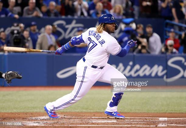 Vladimir Guerrero Jr #27 of the Toronto Blue Jays grounds out in his first Major League atbat in the second inning during MLB game action against the...