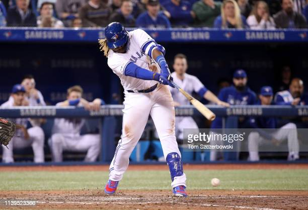Vladimir Guerrero Jr #27 of the Toronto Blue Jays hits a double for his first career MLB hit in the ninth inning during MLB game action against the...