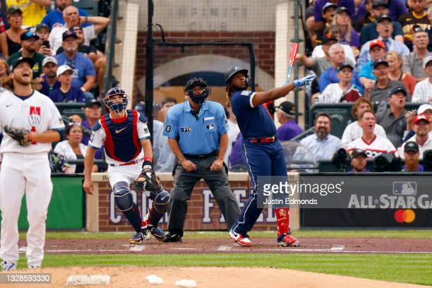 Vladimir Guerrero Jr. #27 of the Toronto Blue Jays hits a home run in the third inning during the 91st MLB All-Star Game at Coors Field on July 13,...