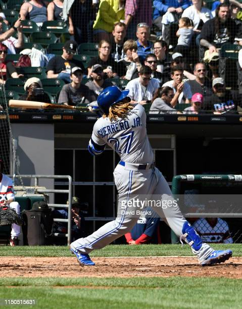 Vladimir Guerrero Jr #27 of the Toronto Blue Jays hits a two run home run against the Chicago White Sox during the eighth inning at Guaranteed Rate...