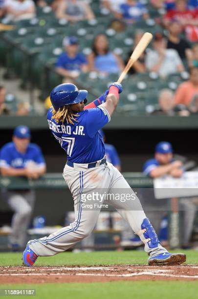 Vladimir Guerrero Jr #27 of the Toronto Blue Jays hits a tworun home run in the third inning against the Baltimore Orioles at Oriole Park at Camden...