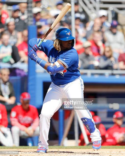 Vladimir Guerrero Jr #27 of the Toronto Blue Jays in action against the Philadelphia Phillies during the Grapefruit League spring training game at...