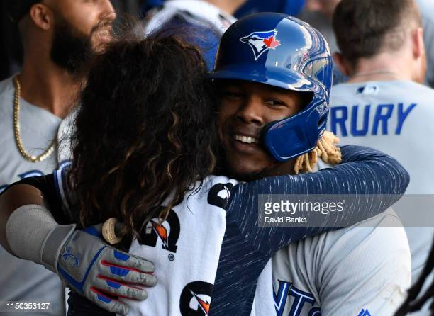 Vladimir Guerrero Jr #27 of the Toronto Blue Jays is greeted by teammates after hitting a two run home run against the Chicago White Sox during the...