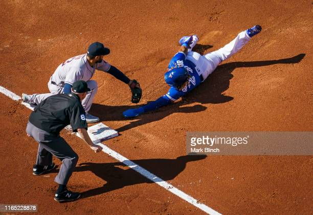 Vladimir Guerrero Jr #27 of the Toronto Blue Jays is out at third base on a tag by Abraham Toro of the Houston Astros in the third inning during...