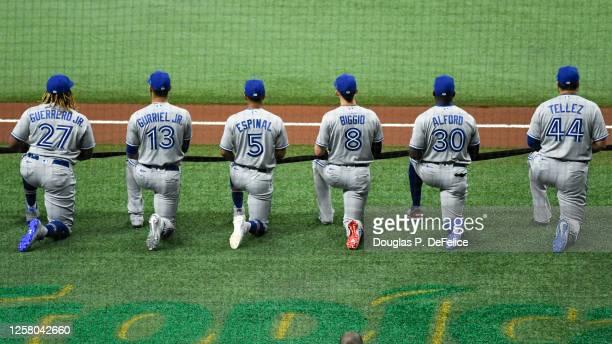 Vladimir Guerrero Jr. #27 of the Toronto Blue Jays, Lourdes Gurriel Jr. #13, Santiago Espinal, Cavan Biggio, Anthony Alford, and Rowdy Tellez take a...