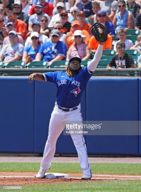 Vladimir Guerrero Jr. #27 of the Toronto Blue Jays makes a catch on a high throw for an out at first base during the second inning against the...