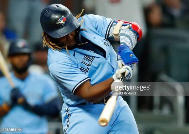 Vladimir Guerrero Jr. #27 of the Toronto Blue Jays pops up in the ninth inning against the Atlanta Braves at Truist Park on May 12, 2021 in Atlanta,...