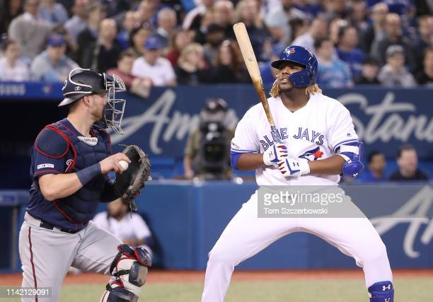 Vladimir Guerrero Jr #27 of the Toronto Blue Jays reacts after being called out on strikes in the second inning during MLB game action against the...