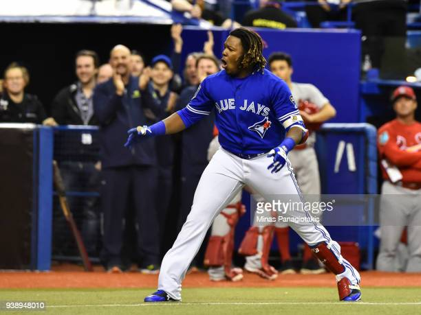 Vladimir Guerrero Jr #27 of the Toronto Blue Jays reacts after hitting a walkoff home run in the bottom of the ninth inning against the St Louis...