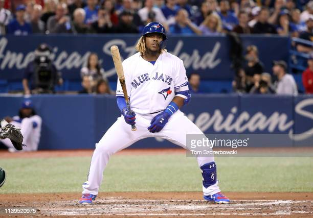 Vladimir Guerrero Jr #27 of the Toronto Blue Jays reacts after taking an inside pitch in the fourth inning during MLB game action against the Oakland...