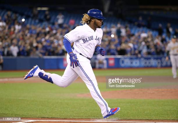 Vladimir Guerrero Jr #27 of the Toronto Blue Jays runs out a groundout in his first career at bat in the second inning during MLB game action against...