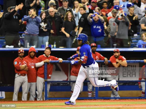 Vladimir Guerrero Jr #27 of the Toronto Blue Jays runs the bases as he hits a walkoff home run against the St Louis Cardinals during the MLB...