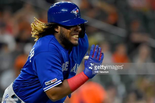 Vladimir Guerrero Jr #27 of the Toronto Blue Jays runs to first base during the fifth inning against the Baltimore Orioles at Oriole Park at Camden...