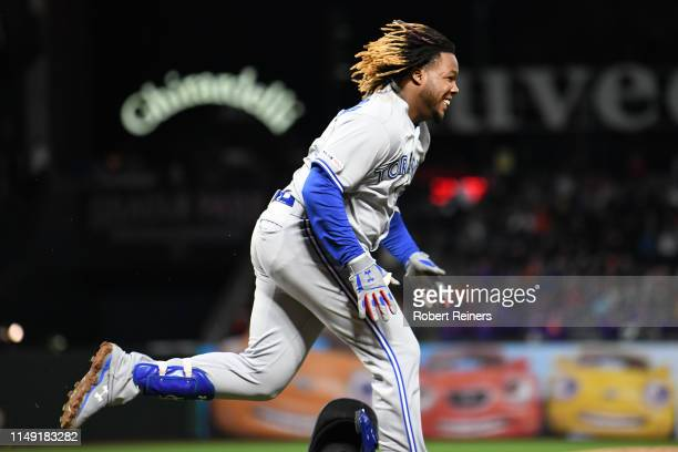Vladimir Guerrero Jr #27 of the Toronto Blue Jays runs to first on a ground out to second in the eighth inning of their MLB game against the San...