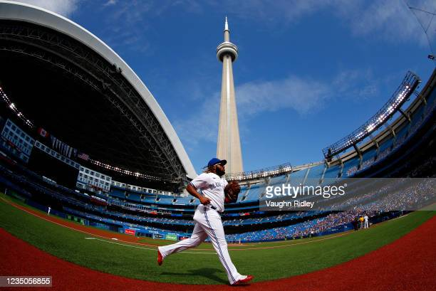 Vladimir Guerrero Jr. #27 of the Toronto Blue Jays runs to the dugout prior to a MLB game against the Oakland Athletics at Rogers Centre on September...