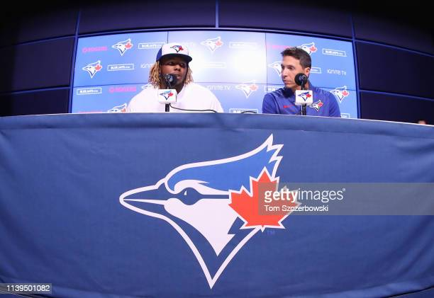 Vladimir Guerrero Jr #27 of the Toronto Blue Jays speaks to the media via interpreter Hector Lebron as he is introduced before his MLB debut later...