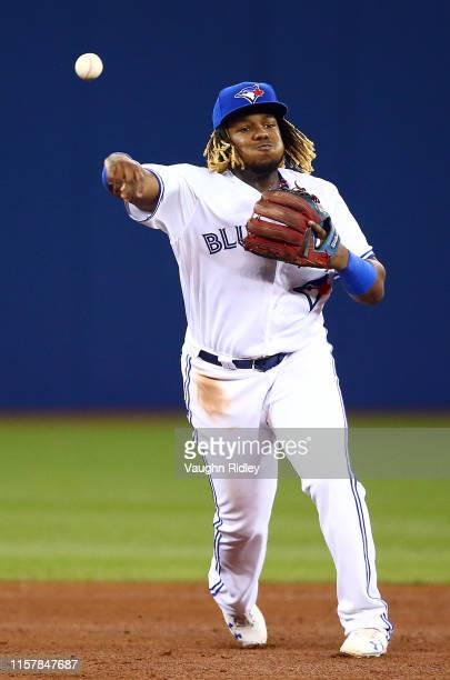 Vladimir Guerrero Jr #27 of the Toronto Blue Jays throws to first base to get Joey Wendle of the Tampa Bay Rays out in the sixth inning during a MLB...