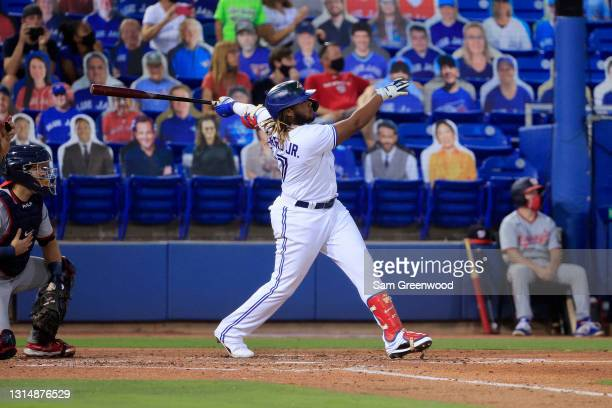 Vladimir Guerrero Jr. #27 of the Toronto Blue Jays watches his grand-slam home run in the third inning against the Washington Nationals at TD...