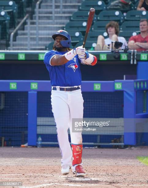 Vladimir Guerrero Jr. #27 of the Toronto Blue Jays watches his two run home run during the fifth inning against the Houston Astros at Sahlen Field on...