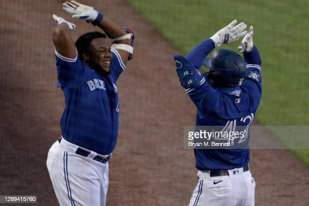 Vladimir Guerrero Jr. #42 of the Toronto Blue Jays and teammate Teoscar Hernandez celebrate after both hitting one run homes run during the fourth...