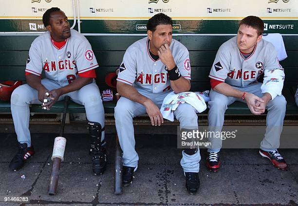 Vladimir Guerrero Juan Rivera and Scott Kazmir of the Los Angeles Angels of Anaheim get ready in the dugout before the game against the Oakland...