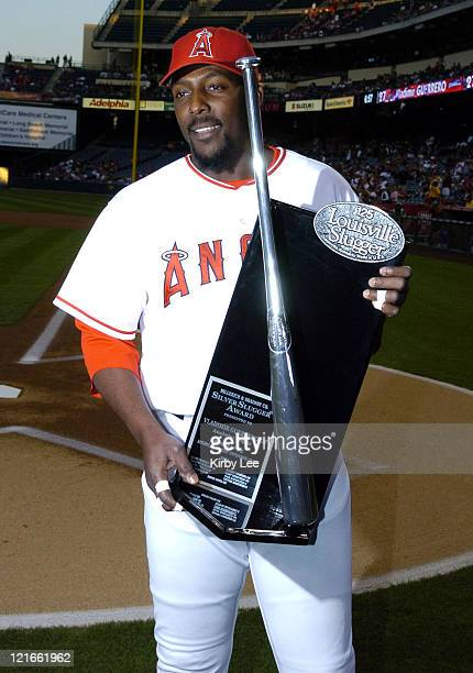 Vladimir Guerrero of Los Angeles Angels of Anaheim is presented the Louisvillle Silver Slugger Award before game against the Texas Rangers at the...