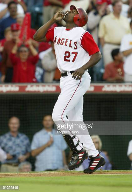 Vladimir Guerrero of the Anaheim Angels celebrates as he approaches home plate after hitting a two run home run in the first inning against the Los...